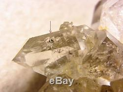 Herkimer Diamond Quartz Crystal with enhydro etcetera. = natural cluster